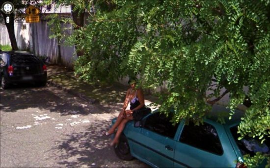 Girl sitting on top of car