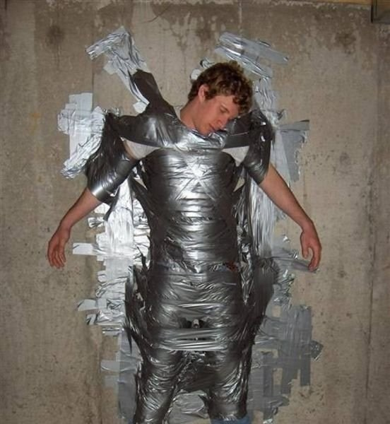 drunk guy taped on wall
