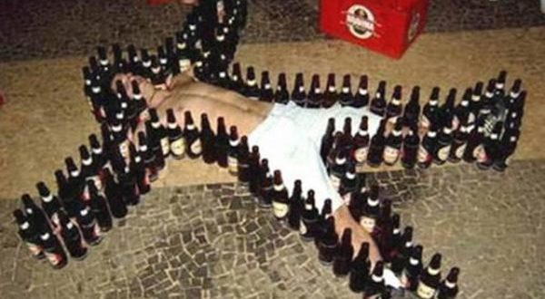 drunk man surrounded with beer bottles