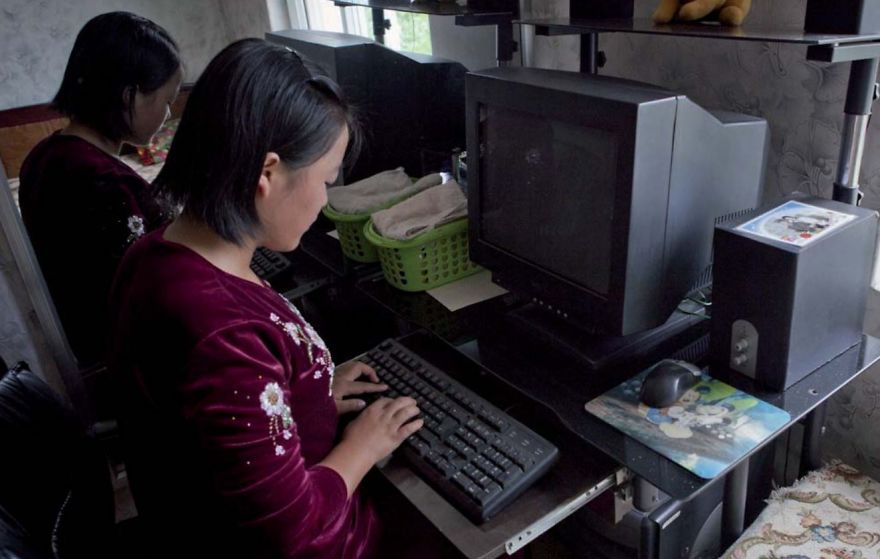 North Korean Girl Working on Old Computer Desktop